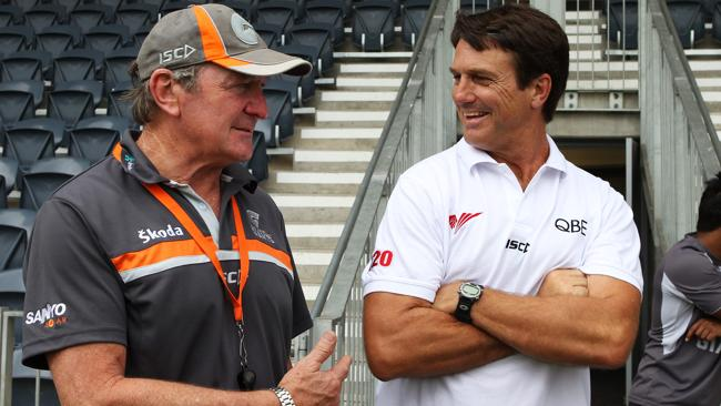 Former Swans coach Paul Roos speaks to the media with GWS Giants coach Kevin Sheedy.