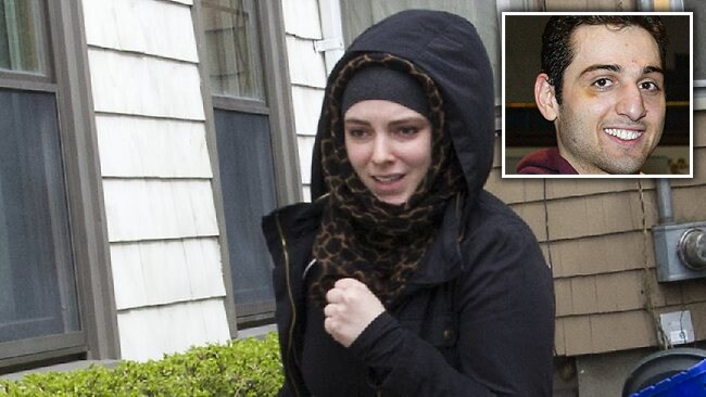 Katherine Russell, the American wife of marathon bomber Tamerlan Tsarnaev, leaves the house where he lived in Cambridge, the day after Tsarnaev, was killed in a shootout with police. Picture: Austral via William Farrington / Polaris