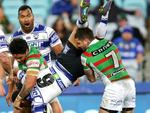 South Sydney's Adam Reynolds and Issac Luke tackle Bulldog's Moses Mbye and Reynolds ends up on report during the NRL game between the Canterbury Bankstown Bulldogs and the South Sydney Rabbitohs at ANZ Stadium. Picture Gregg Porteous