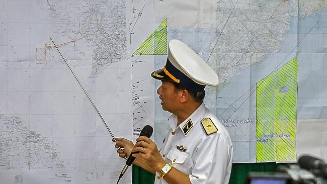 Vietnamese Navy's Deputy Commander Rear Admiral Le Minh Thanh shows the area where Vietnam was conducting its search activities for MH370. Picture: AFP