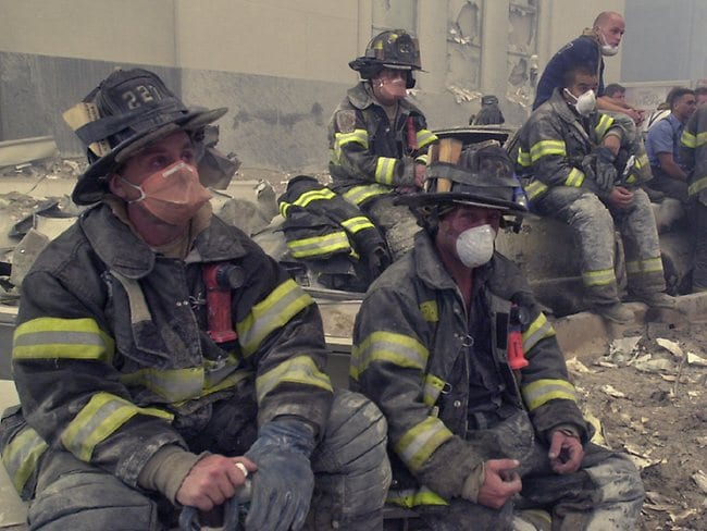 Firemen taking a break. Devastated like every other New Yorker on 9/11.