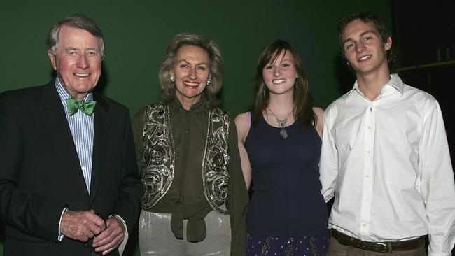 Harriet Wran with former politician father Neville, mother Jill and a guest at a charity evening in 2005.