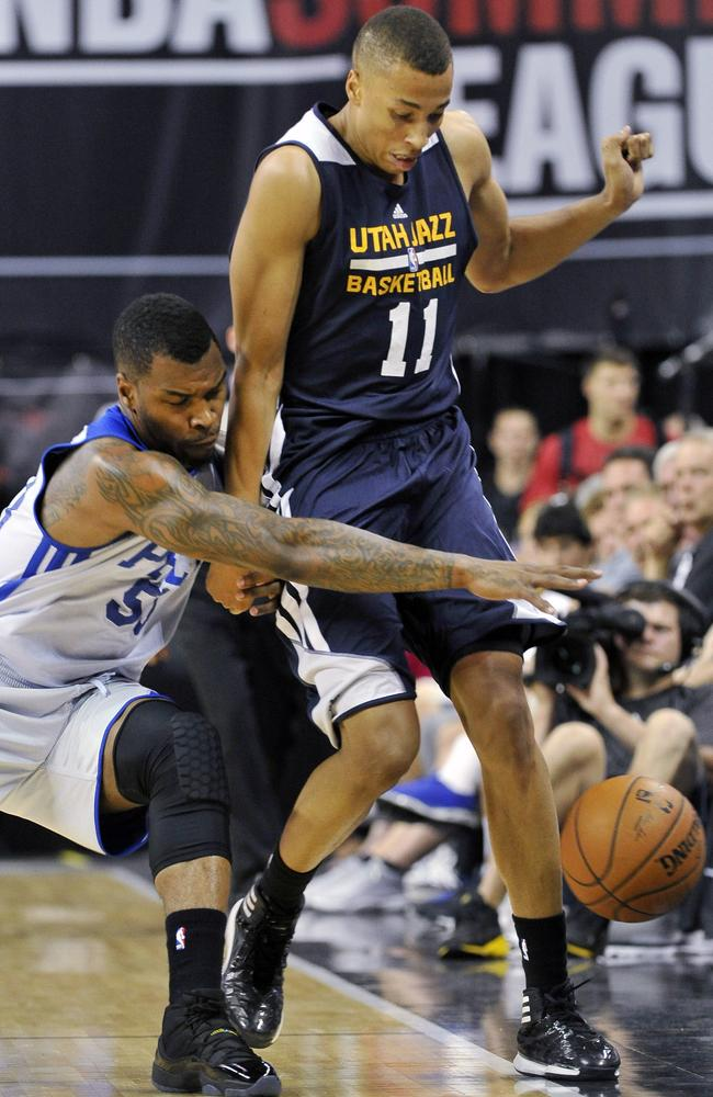 Dante Exum shields the ball from the Philadelphia 76ers' Sean Kilpatrick.