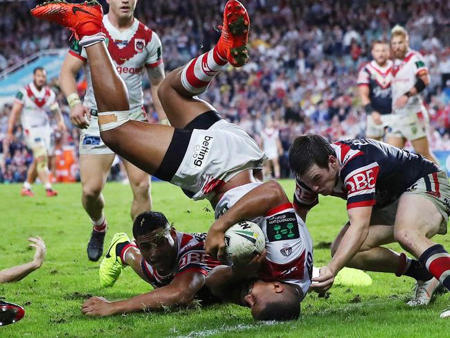 Phil Hillyard was in the thick of the action when St George's Nene Macdonald appeared to score a try on his head.