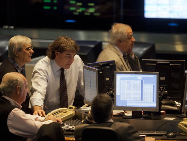 Brokers work at the Buenos Aires Stock Exchange in Buenos Aires, Argentina.