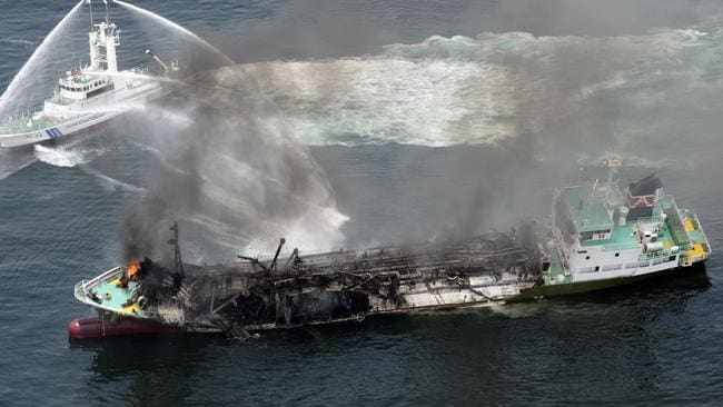 Destroyed ... black smoke rises from Shoko Maru, a 998-ton tanker, after it exploded in waters off Himeji port, western Japan. Picture: Kyodo News