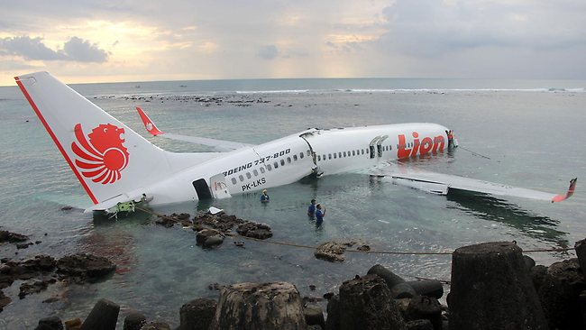 This handout photo released by the Indonesian Police on April 13, 2013 shows a Lion Air Boeing 737 submerged in the water after skidding off the runaway during landing at Bali's international airport near Denpasar.