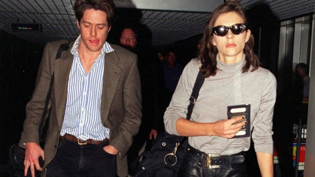 Hugh Grant and Liz Hurley at the airport returning from the South of France. Photo: File