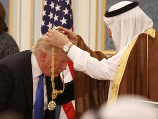 Saudi King Salman presents President Donald Trump with The Collar of Abdulaziz Al Saud Medal at the Royal Court Palace in Riyadh. Picture: AP