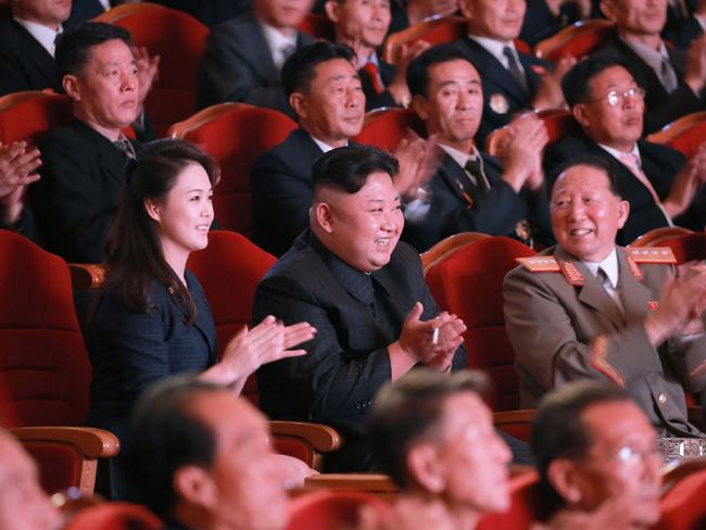 North Korean leader Kim Jong-Un and his wife Ri Sol-Ju attending an art performance dedicated to nuclear scientists and technicians. Picture KCNA via AFP