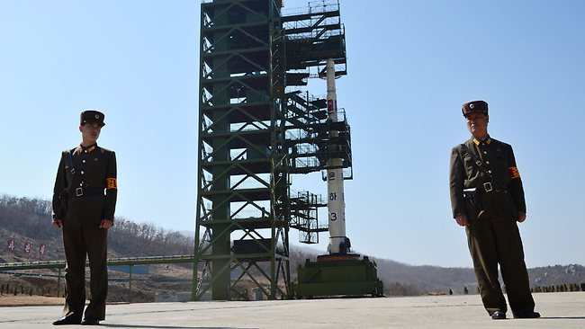North Korean soldiers guard an Unha-3 rocket (developed from the Taepodong-2) at the Tangachai-ri space centre; Pyongyang says it can strike the US mainland.