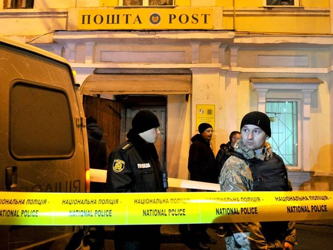 Ukrainian policemen are seen after storming the office of the Ukrposhta postal service. Picture: AFP