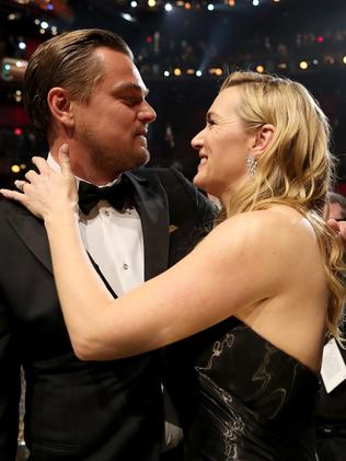 Kate Winslet congratulates Leo on his win. Picture: Christopher Polk/Getty Images