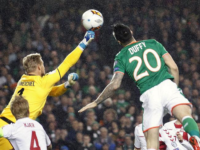 Ireland's Shane Duffy heads the ball to score his side's first goal. (AP Photo/Peter Morrison)