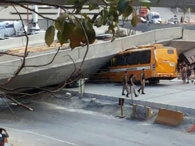 Collapse ... a local police image shows a bus crushed under the fallen bridge in Belo Horizonte.