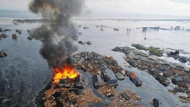 Houses were swallowed by tsunami waves and burned in Natori, Miyagi Prefecture (state) after Japan was struck by a strong earthquake off its northeastern coast on March 11, 2011. Picture: Kyodo News