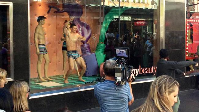 Fans of The Ellen Show gathered in Melbourne's Bourke Street mall to watch underwear model Mike strut his stuff in the Myer windows.