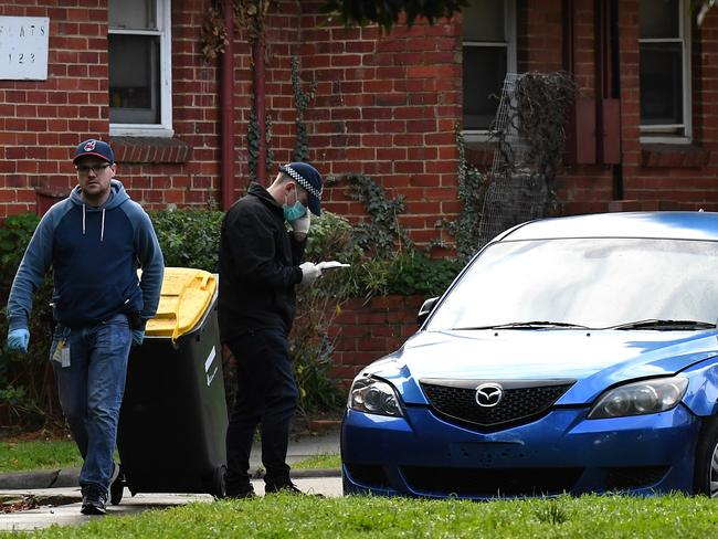 AFP officers search an apartment and these two cars in Churchill Avenue, Ascot Vale. Picture: Nicole Garmston
