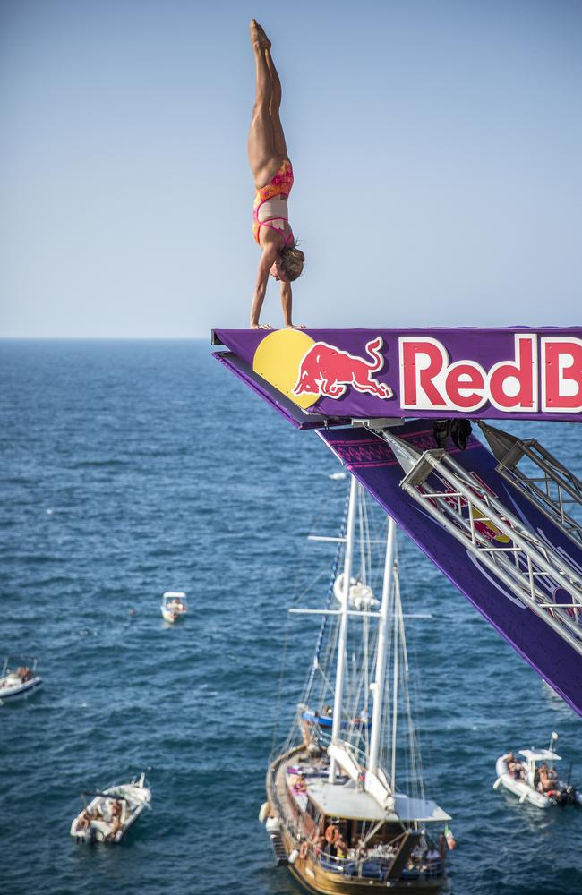 Helena Merten of Australia dives from the 21.5m platform at the Red Bull Cliff Diving World Series in Polignano a Mare, Italy. Picture: Red Bull