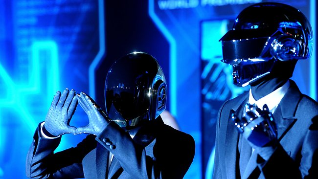 Masked identities: Daft Punk performing in their trademark robotic helmets. Picture: Getty Images