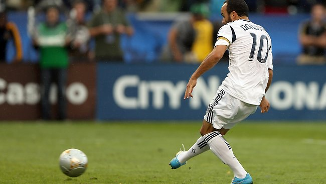 Landon Donovan scores from the penalty spot to give Los Angeles Galaxy a 2-1 lead in in the second half against the Houston Dynamo in the 2012 MLS Cup. Picture: Jeff Gross