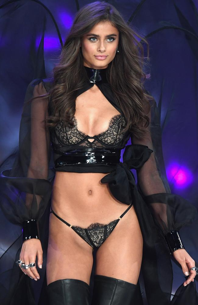 Taylor Hill shows off her signature long, lush locks on the Victoria's Secret runway.