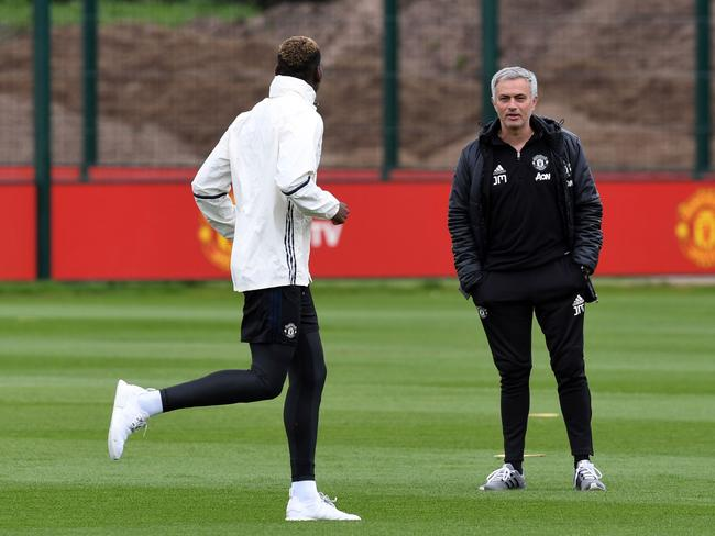 Manchester United's Portuguese manager Jose Mourinho (R) chats to Manchester United's French midfielder Paul Pogba.