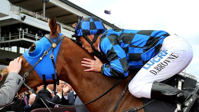 Damian Browne kisses Buffering after his second Group 1 win in consecutive races.