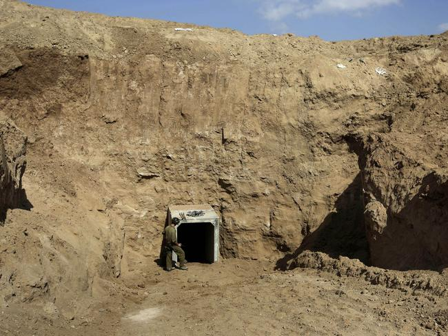 An Israeli soldier stands at the exit of a tunnel discovered near the Israel Gaza border. Picture: Tsafrir Abayov