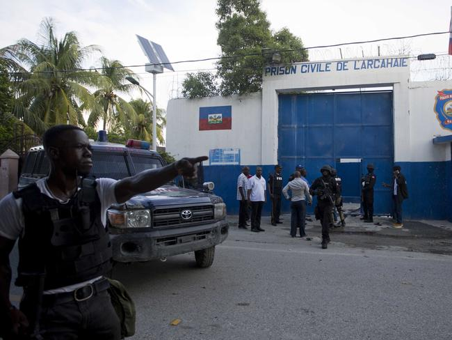 Police gather at the Civil Prison after some of the inmates escaped. Picture: AP/Dieu Nalio Chery