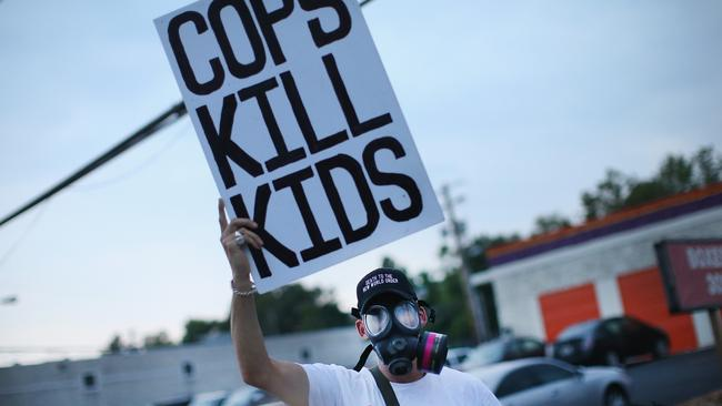Straight talking ... a demonstrator protests along Florissant Avenue in Ferguson, Missouri. Picture: Scott Olson/Getty Images/AFP