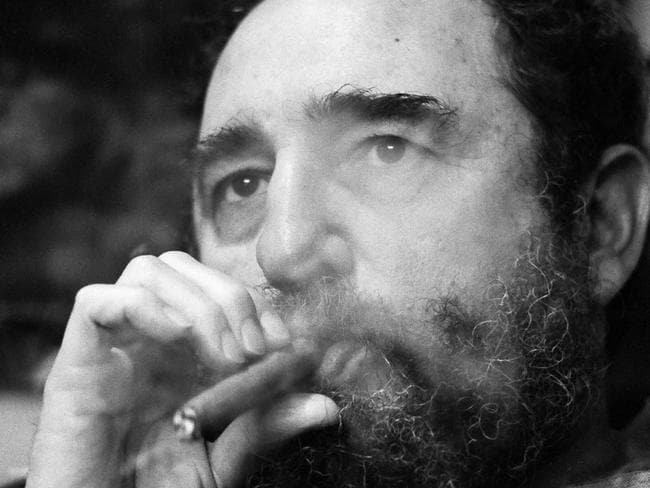 Fidel Castro smoking a cigar in Havana in 1977. Picture: Supplied