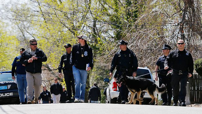 WATERTOWN, MA - APRIL 22: Members of law enforcement, including many K-9 units, investigate the scene while executing a second sweep of the area around Franklin Street on April 22, 2013 in Watertown, Massachusetts. A manhunt ended for Dzhokhar A. Tsarnaev, 19, a suspect in the Boston Marathon bombing after he was apprehended on a boat parked on a residential property in Watertown, Massachusetts. He has been charged with one count of using a weapon of mass destruction and one count of malicious destruction of property by means of an explosive device resulting in death. His brother Tamerlan Tsarnaev, 26, the other suspect, was shot and killed after a car chase and shootout with police. The bombing, on April 15 at the finish line of the marathon, killed three people and wounded at least 170. Jared Wickerham/Getty Images/AFP== FOR NEWSPAPERS, INTERNET, TELCOS & TELEVISION USE ONLY ==