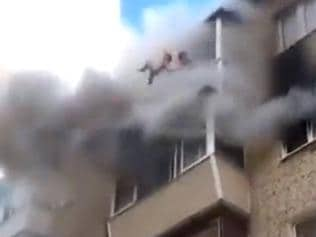 Supplied Editorial Russian family jump from burning flat. Picture: Live Leak