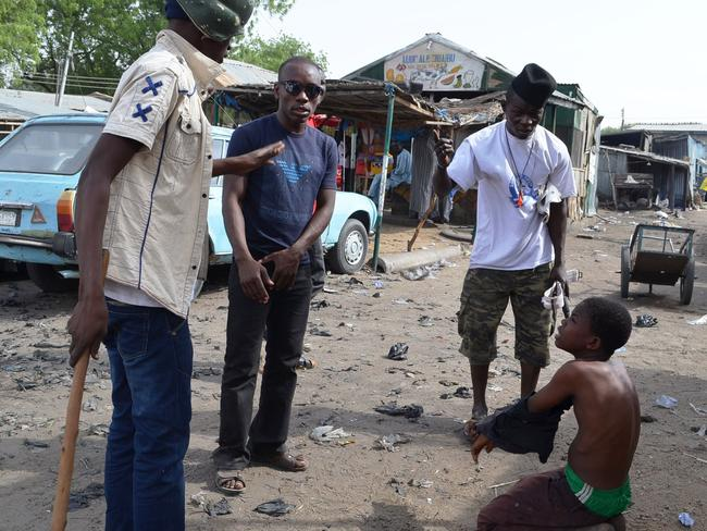 Deadly raids ... vigilantes interrogate a suspected Boko Haram informant in the northeast Nigerian city of Maiduguri on May 24, 2014. Picture: Aminu Abubakar