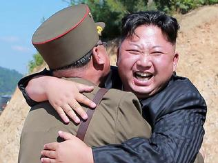 "TOPSHOT - This picture taken on July 4, 2017 and released by North Korea's official Korean Central News Agency (KCNA) on July 5, 2017 shows North Korean leader Kim Jong-Un (C) celebrating the successful test-fire of the intercontinental ballistic missile Hwasong-14 at an undisclosed location. South Korea and the United States fired off missiles on July 5 simulating a precision strike against North Korea's leadership, in response to a landmark ICBM test described by Kim Jong-Un as a gift to ""American bastards"". / AFP PHOTO / KCNA VIA KNS / STR / South Korea OUT / REPUBLIC OF KOREA OUT ---EDITORS NOTE--- RESTRICTED TO EDITORIAL USE - MANDATORY CREDIT ""AFP PHOTO/KCNA VIA KNS"" - NO MARKETING NO ADVERTISING CAMPAIGNS - DISTRIBUTED AS A SERVICE TO CLIENTS THIS PICTURE WAS MADE AVAILABLE BY A THIRD PARTY. AFP CAN NOT INDEPENDENTLY VERIFY THE AUTHENTICITY, LOCATION, DATE AND CONTENT OF THIS IMAGE. THIS PHOTO IS DISTRIBUTED EXACTLY AS RECEIVED BY AFP. /"