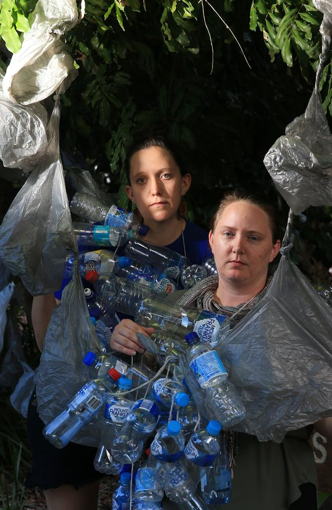 Volunteer for the Marine Response Team, Lucy Graham and Roz Walden, with plastic bags and bottles they've collected. Picture: Justin Brierty