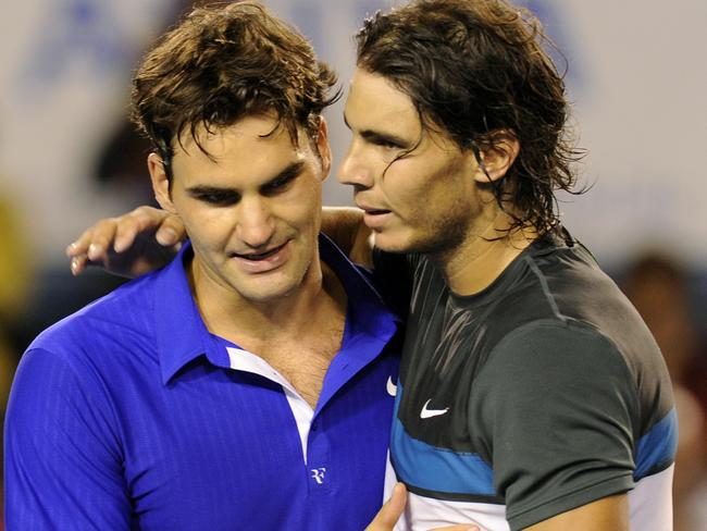 Epic game ... Rafael Nadal hugs Roger Federer after he won the Men's singles final match at the Australian Open Tennis Championship