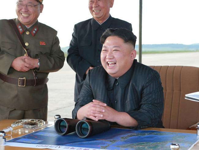 North Korean leader Kim Jong-un attends what was said to be the test launch of an intermediate range Hwasong-12 missile at an undisclosed location in North Korea. Picture: Korean Central News Agency/Korea News Service via AP, File