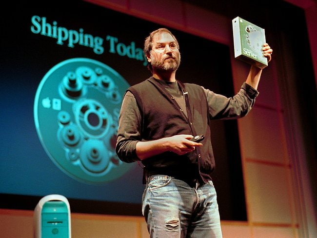 MARCH 16, 1999 : Steve Jobs, president & chief executive officer of Apple Computer, holds a copy of his company's new software server, at a media conference in Cupertino, California, 16/03/99. Pic AP.P/