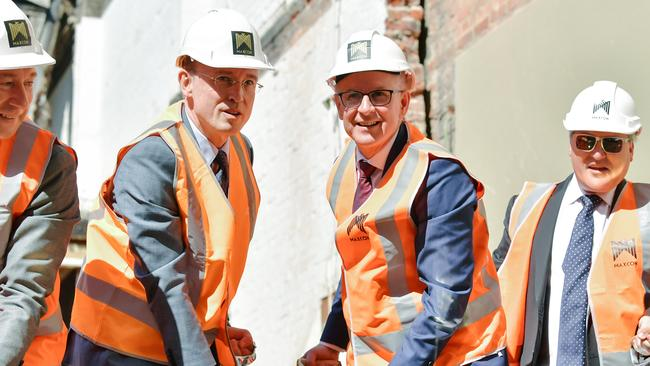Adelaide Lord Mayor Martin Haese and Premier Jay Weatherill turn the soil at the construction site of the Realm Adelaide apartment complex at 19 Austin St Adelaide. AAP Image/Morgan Sette