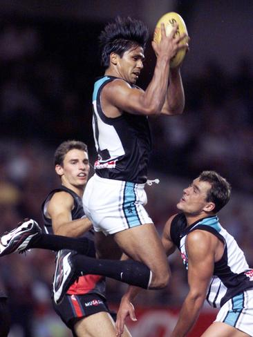 Che Cockatoo-Collins takes a strong mark for the Power against Essendon in 2000.