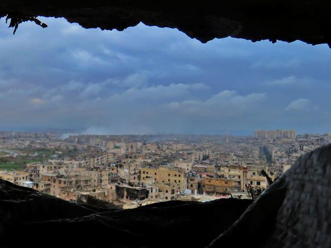 Smoke can be seen in Aleppo's southeastern al-Zabdiya neighbourhood following government strikes yesterday. Picture: AFP