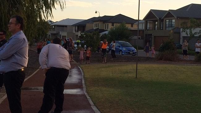 Balcatta residents look on as fire crews battle a fire near Grindleford Drive.