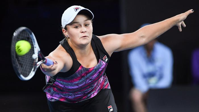 Australia's Ashleigh Barty hits a return against Germany's Mona Barthel during their women's singles third round match on day five of the Australian Open tennis tournament in Melbourne on January 20, 2017. / AFP PHOTO / WILLIAM WEST / IMAGE RESTRICTED TO EDITORIAL USE - STRICTLY NO COMMERCIAL USE