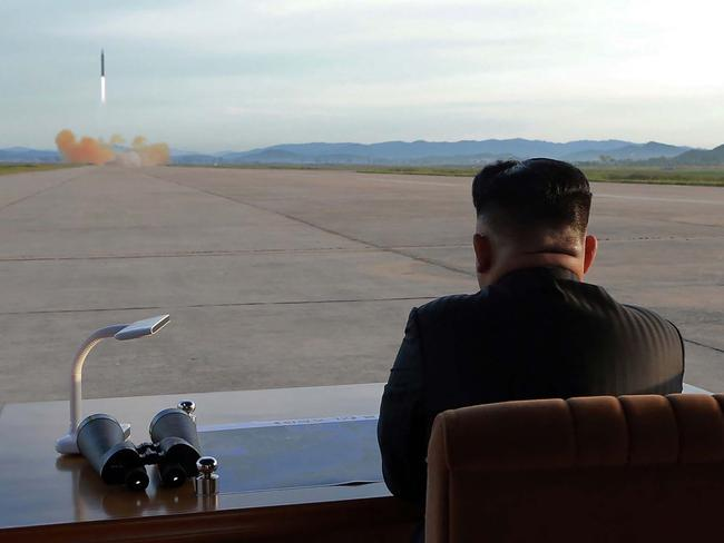 North Korean leader Kim Jong-un observes a launch of the medium-and-long range strategic ballistic rocket Hwasong-12 last month. Picture: KCNA via KNS