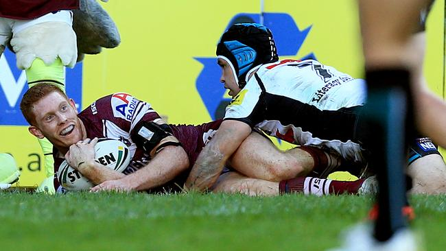 Tom Symonds scores the match winning try for Manly.