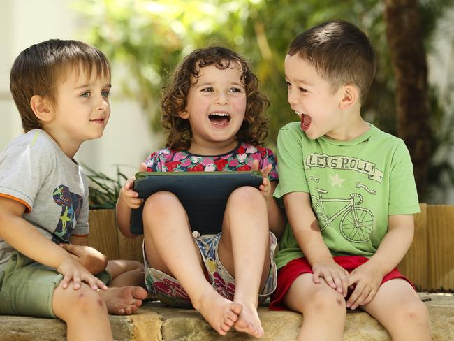 Jaxon Stannard-Rowley, 4, Evie Chardon, 4, and Lucas Whitmore, 4, at Explore & Develop in Camperdown, Sydney where they are learing Mandarin. Picture: Justin Lloyd