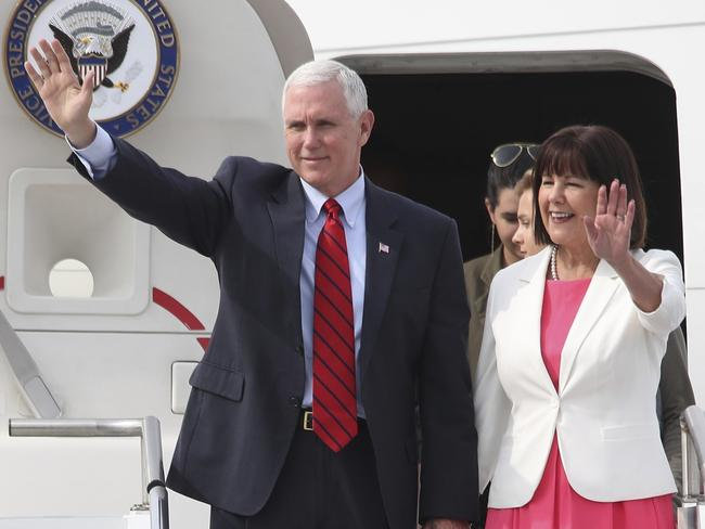 US Vice President Mike Pence and his wife Karen wave upon their arrival at Osan Air Base in Pyeongtaek, South Korea on Sunday. Picture: Kim Do-hoon/AP