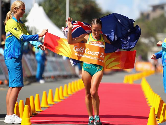 Jemima Montag crosses the line as she celebrates her gold medal in the Women - Commonwealth Games Day 4 Medal Tally, Swimming, Athletics Results, Kerri Pottharst Racial Comment's 20km Race Walk